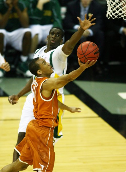 Texas Longhorn Avery Bradley tries to shoot around the outstretched arm of Baylor Bear Ekpe Udoh at the Sprint Center in Kansas City, Missouri on March 11, 2010. UPI/Jay Biggerstaff
