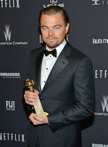 Leonardo DiCaprio holds his Golden Globe award for Best Actor in a Comedy as he attends the Weinstein Company and Netflix after party in Los Angeles, California on January 12, 2014. UPI/Christine Chew