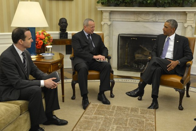U.S. President Barack Obama (R) meets with Special Presidential Envoy for the Global Coalition to Counter ISIS Gen. John Allen (C) and Deputy Special Presidential Envoy Brett McGurk for talks in the Oval Office on combating the Islamic State of Iraq and Syria (ISIS), September 16, 2014, in Washington, DC. UPI/Mike Theiler
