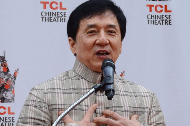 Jackie Chan participates in a hand and footprint ceremony at the TCL Chinese Theatre on June 6, 2013. Protesters in Taiwan vandalized statues the actor donated to a newly opened museum due to his ties to China's Communist party. File Photo by Jim Ruymen/UPI