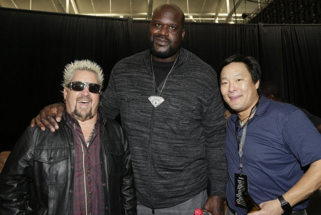 Guy Fieri, Shaquille O'Neal and Ming Tsai stand together at the Wheels Up Super Saturday Tailgate party in an event leading up to Super Bowl 50 on February 6, 2016 in San Francisco, California. The Denver Broncos will play the Carolina Panthers on Sunday for Super Bowl 50 at Levi Stadium. Photo by John Angelillo/UPI