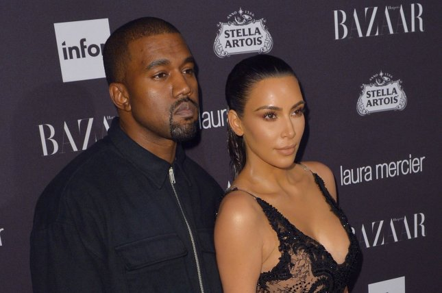 Kim Kardashian (R) and Kanye West at the Harper's Bazaar Icons party on September 9. The couple share daughter North West and son Saint West. File Photo by Andrea Hanks/UPI