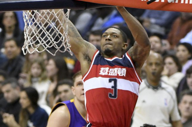 1b1536caa367 Washington Wizards guard Bradley Beal (3) dunks the ball against Los  Angeles Lakers guard Nick Young (0) in the first half at the Verizon Center  in ...