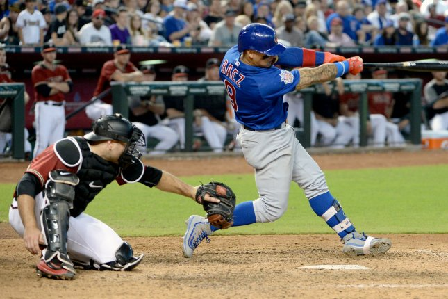 0b29513ec Chicago Cubs' Javier Baez (R) hits a three run home run in the in the  eighth inning of the Cubs-Arizona Diamondbacks game at Chase Field in  Phoenix, ...