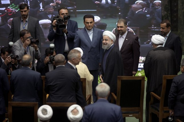Iranian President Hassan Rouhani (R) arrives for his inauguration ceremony at the parliament in Tehran, Iran, on August 5. File Photo by Maryam Rahmanian/UPI
