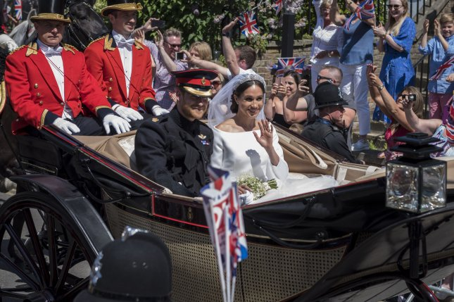 Prince Harry (L) and Meghan Markle take a carriage ride through Windsor, England, following their wedding on Saturday. Photo by Stephen Chung/UPI