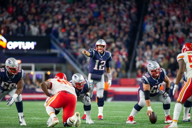 New England Patriots quarterback Tom Brady (12) calls a play on the line of scrimmage in the fourth quarter against the Kansas City Chiefs at Gillette Stadium in Foxborough, Mass., on Sunday night. The Patriots defeated the Chiefs 43-40. Photo by Matthew Healey/UPI