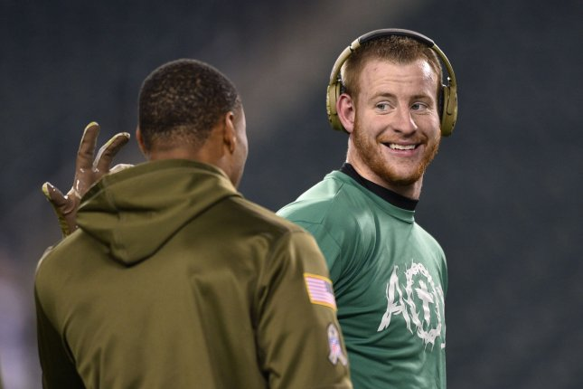 Philadelphia Eagles quarterback Carson Wentz (R) was an MVP candidate in 2017, but missed five games in 2018. File Photo by Derik Hamilton/UPI