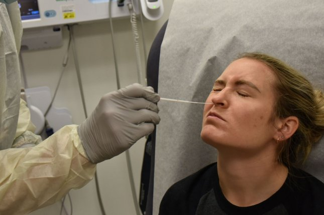More widespread testing could help clinicians more accurately determine who has recovered from COVID-19. File photo by Twana Atkinson/U.S. Army/UPI