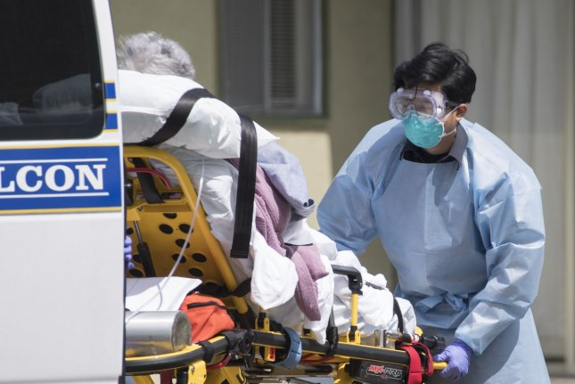 A patient is moved out of nursing facility in California on April 9. A new study estimated the U.S. death rate for COVID-19 to be 1.3 percent of detected cases. Photo by Terry Schmitt/UPI