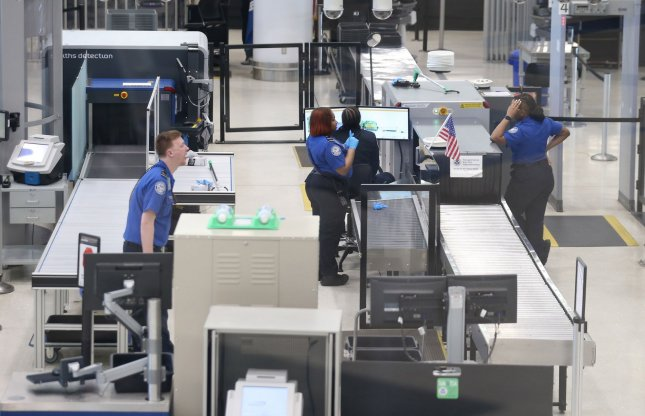 TSA agents talk among themselves as they wait for passengers at St. Louis-Lambert International Airport in St. Louis last year. File Photo by Bill Greenblatt/UPI