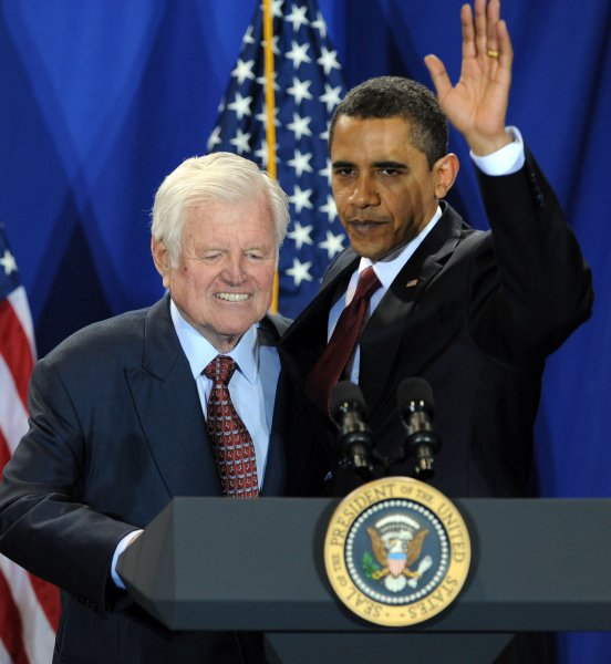 Sen. Edward Kennedy, D-Mass., who died Tuesday at 77, is pictured shaking hands with President Barack Obama at a signing ceremony for the Edward M. Kennedy Serve America Act, April 21, 2009. (UPI Photo/Roger L. Wollenberg)