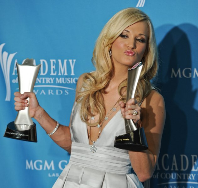Carrie Underwood arrives in the photo room at the Academy of Country Music (ACM) Awards in Las Vegas, Nevada on April 18, 2010. Underwood won Entertainer of the Year and the ACM Triple Crown. UPI/Alexis C. Glenn