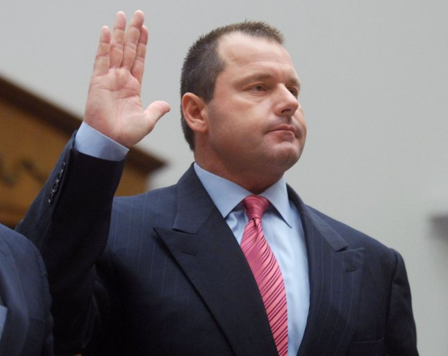 New York Yankees pitcher Roger Clemens, seen in this February 13, 2008 file photo being sworn in prior to testifying before Congress on steroid use. (UPI Photo/Kevin Dietsch/Files)