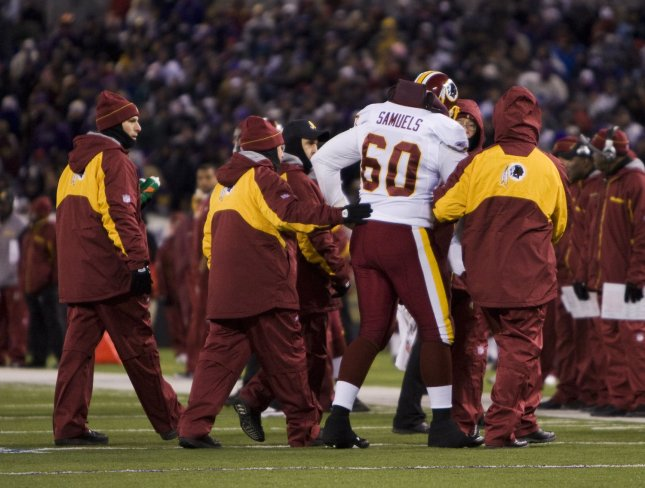 Washington Redskins Chris Samuels is helped off the field during the fourth quarter against the Baltimore Ravens at M&T Bank Field in Baltimore, Maryland on December 7, 2008. (UPI Photo/Patrick D. McDermott)