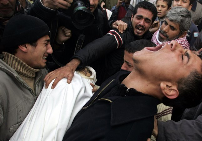 Palestinian relatives cry during the funeral of five children and their mother (Batran family) killed during Israeli strikes at the Bureij Refugee Camp in southern Gaza city on January 17, 2009. (UPI Photo/Ismael Mohamad)