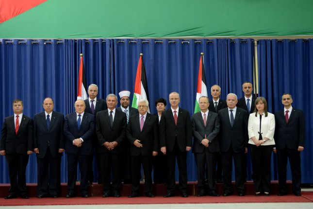 A photo of the new Palestinian unity government after the swearing in ceremony in the Presidential compound in Ramallah, West Bank, June 2, 2014. It is the first time in seven years that Hamas and Fatah have joined together in unity to have one government in charge of the West Bank and Gaza. Israel denied three ministers from Hamas in Gaza to enter the West Bank for the ceremony. UPI/Debbie Hill