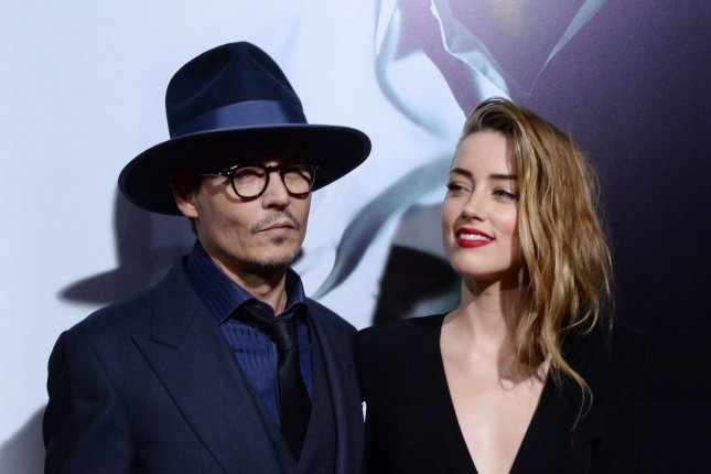 Amber Heard and Johnny Depp in a 2014 UPI file photo.