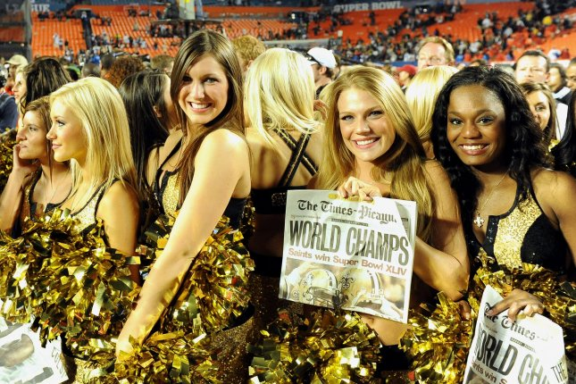 New Orleans Saints cheerleaders celebrate on the field after the Saints defeated the Indianapolis Colts 31-17 in Super Bowl XLIV at Sun Life Stadium in Miami on February 7, 2010. Brees was named MVP for the game. UPI/Rob Hobson