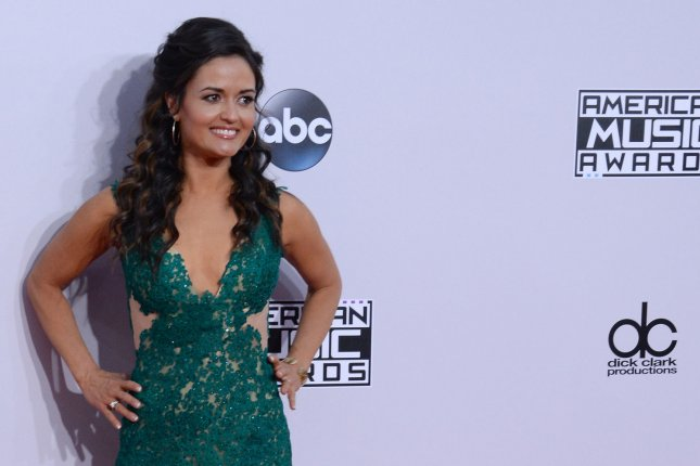 Actress Danica McKellar arrives for the 42nd annual American Music Awards held at Nokia Theatre L.A. Live in Los Angeles on Nov. 23, 2014. Photo by Jim Ruymen/UPI
