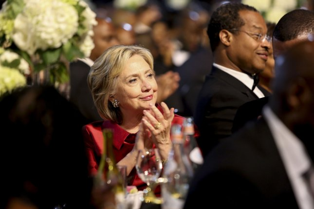 Democratic presidential candidate Hillary Clinton applauds a speaker Sept. 19 at the Congressional Black Caucus Foundation's 45th Annual Legislative Conference Phoenix Awards Dinner at the Walter E. Washington Convention Center. Wednesday, Clinton came out against the Trans-Pacific Partnership trade agreement. Pool photo by Aude Guerrucci/UPI