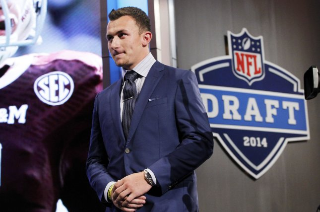 Texas A&M quarterback Johnny Manziel walks on the stage before the start of the 2014 NFL Draft at Radio City Music Hall in New York City on May 8, 2014. South Carolina defensive end Jadeveon Clowney was the #1 overall pick by the Houston Texans. Photo by John Angelillo/UPI