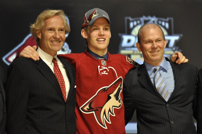 Henrik Samuelsson poses with members of Phoenix Coyotes after being chosen as the 27th pick during the first round of the 2012 NHL Draft at the Consol Energy Center in Pittsburgh PA on June 22, 2012. UPI/Archie Carpenter