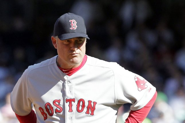 Boston Red Sox manager John Farrell stands on the field. File photo by John Angelillo/UPI