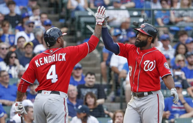 Washington Nationals teammates Brian Goodwin and Howie Kendrick (L) celebrate during a recent game. Photo by Kamil Krzaczynski/UPI