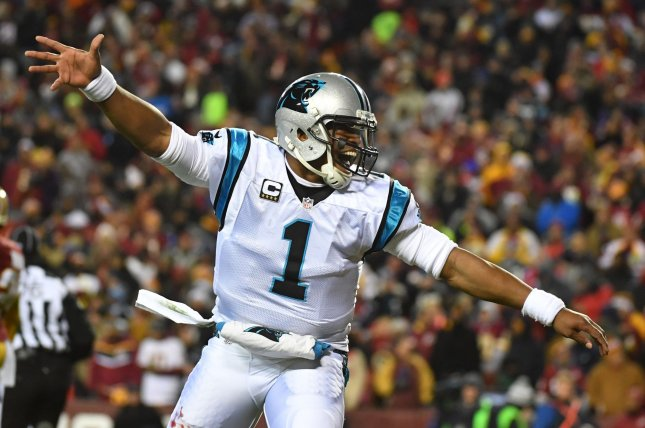 Carolina Panthers quarterback Cam Newton (1) celebrates after throwing a 30-yard touchdown pass to Ted Ginn Jr. against the Washington Redskins in the first quarter at FedEx Field in Landover, Maryland on December 19, 2016. File photo by Kevin Dietsch/UPI