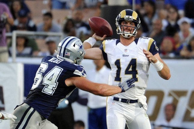 Former Los Angeles Rams quarterback Sean Mannion (14) will sign with the Minnesota Vikings. Mannion walked in free agency after the Rams signed former Jacksonville Jaguars quarterback Blake Bortles. File Photo by Lori Shepler/UPI