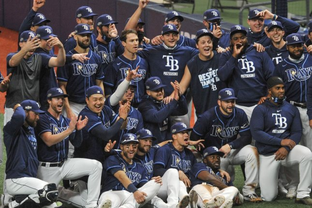 Tampa Bay Rays players and coaches gather for a team photo after an 8-2 win over the Toronto Blue Jays in their American League Wild Card Series game Wednesday at Tropicana Field in St. Petersburg, Fla. Photo by Steve Nesius/UPI