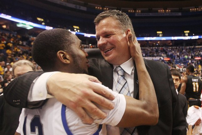 Creighton Bluejays men's basketball coach Greg McDermott (R) said he used the word plantation twice as part of an analogy promoting team unity after a loss to Xavier on Feb. 27. File Photo by Bill Greenblatt/UPI