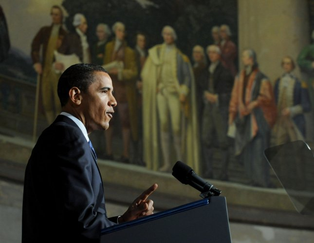 U.S. President Barack Obama discusses his administration's approach to balancing America's national security and governmental transparency in a speech at the National Archives in Washington on May 21, 2009. Obama also spoke about his administration's plans to deal with the terrorist detainee camp at Guantanamo Bay in Cuba. Behind Obama is a portrait depicting the creation of the U.S. Constitution. (UPI Photo/Roger L. Wollenberg)