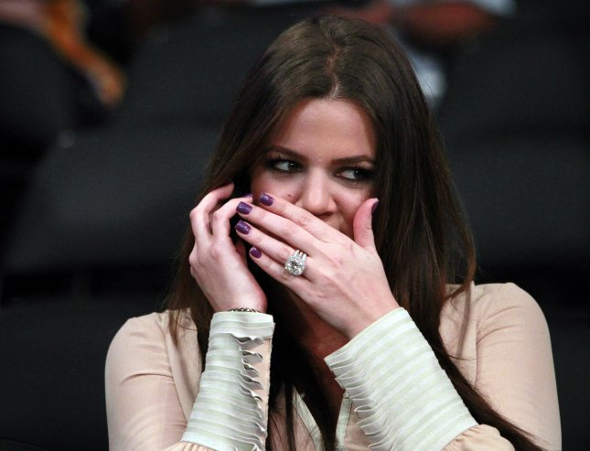 Reality star Khloe Kardashian covers her mouth as she talks on a cell phone before the start of Game 2 of the Western Conference semifinals between the Dallas Mavericks and the Los Angeles Lakers on May 4, 2011. The Mavericks defeated the Lakers 93-81and lead the best-of-seven playoff series 2-0. UPI/Christine Cotter