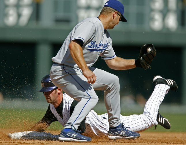 Colorado Rockies center fielder Cory Sullivan slides safely into second base for a double against Los Angeles Dodgers second baseman Jeff Kent (R) in the fourth inning at Coors Field in Denver on September 18, 2007. Colorado beat Los Angeles 3-1 in the first game of a split doubleheader. (UPI Photo/Gary C. Caskey)