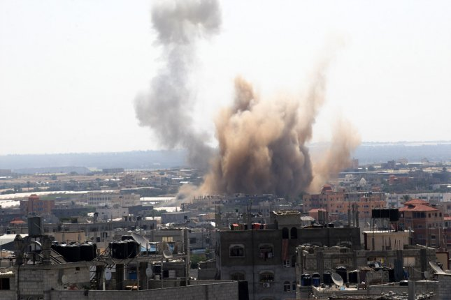 Smoke rises over Rafah in the southern Gaza Strip after an Israeli strike on August 8, 2014. Hamas rejected an extension of the three-day truce being negotiated in Egypt since they say Israel rejected all of the Hamas demands. UPI/Ismael Mohamad