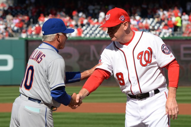 New York Mets Manager Terry Collins (L) shakes hands with Washington Nationals Manager Matt Williams during pregame ceremonies on Opening Day at Nationals Park on April 6, 2015 in Washington, DC. Mets won 3-1 Photo by Pat Benic/UPI