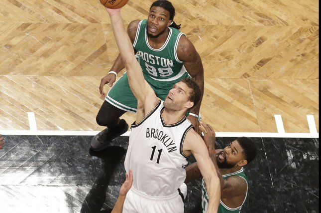 Brooklyn Nets Brook Lopez leaps for a rebound in the first half against the Boston Celtics at Barclays Center in New York City on November 22, 2015. Photo by John Angelillo/UPI