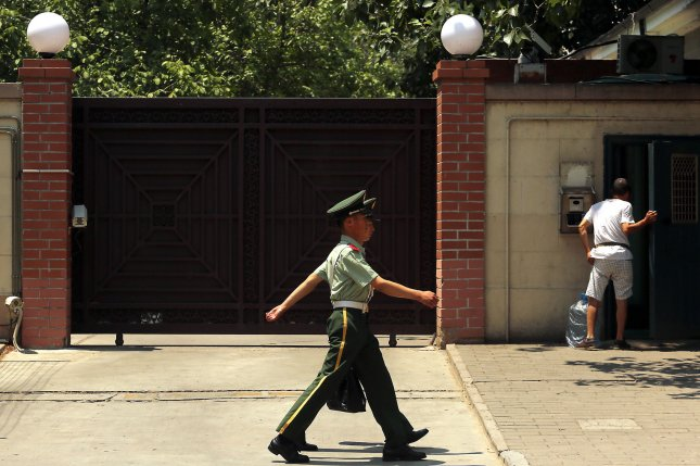 A Chinese soldier stands guard outside the North Korean embassy in Beijing. Defectors continued to be detained in China even as they try to make their way to a third country, according to a recent report. File File Photo by Stephen Shaver/UPI