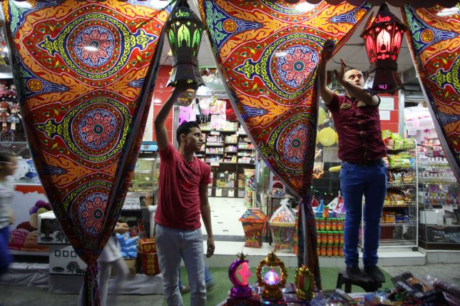 Palestinian shopkeepers in Gaza hang traditional lanterns known in Arabic as fanous, which are sold during the Muslim holy month of Ramadan. More than 1.5 billion Muslims around the world will mark the month, during which believers abstain from eating, drinking, smoking and having sex from dawn until sunset. Photo by Ismael Mohamad/ UPI