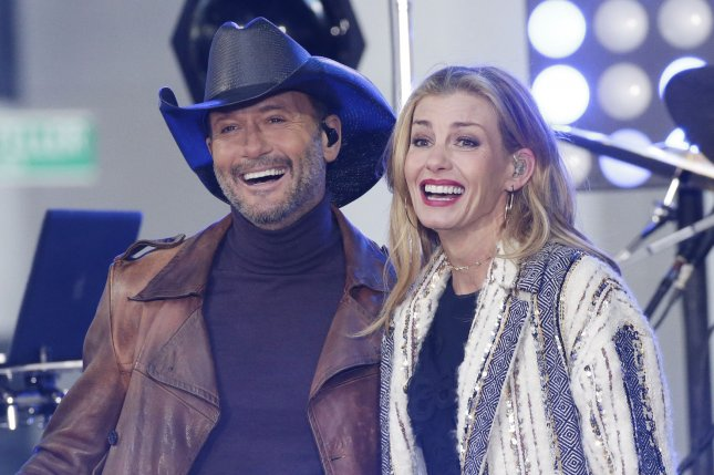 Tim McGraw (L) and his wife Faith Hill. Hill informed concert goers in Ireland that McGraw would be unable to perform after he collapsed. File Photo by John Angelillo/UPI