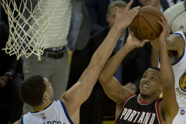 Portland Trail Blazers C.J. McCollum left Saturday's game with a knee injury that following a MRI has been reveled to be a strain. File Photo by Terry Schmitt/UPI