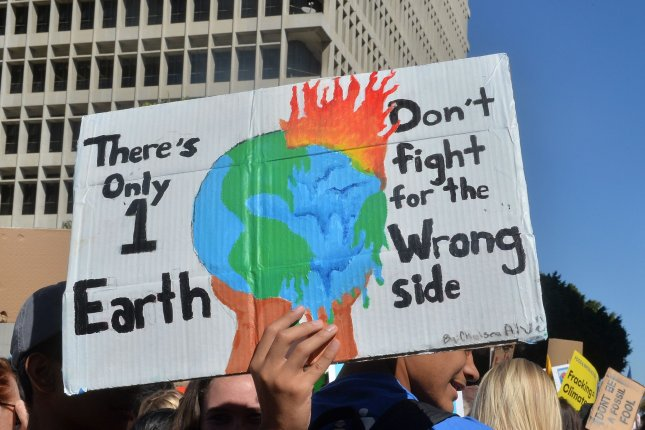 Protesters urge action on climate change outside Los Angeles City Hall on November 1.  File Photo by Jim Ruymen/UPI