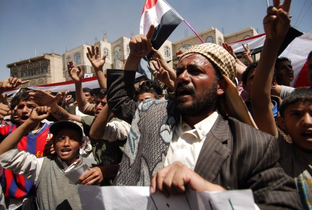 Yemeni protesters chant slogans calling for ouster of President Ali Abdullah Saleh during a massive anti-regime rally in the capital Sanaa , Yemen on March 3, 2011 as Yemen's opposition and clerics offered Saleh a smooth exit from power by the end of this year. UPI/Mohammad Abdullah