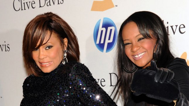 Late singer Whitney Houston (L) with her daughter Bobbi Kristina Brown. Whitney Houston's mother, Cissy, has said she supports the new reality TV show about the family. UPI/Jim Ruymen