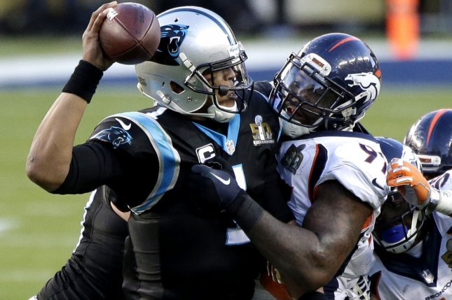 Denver Broncos' Malik Jackson makes contact with Carolina Panthers' Cam Newton as he throws a pass in the second quarter at Super Bowl 50 in Santa Clara, California on February 7, 2016. The Denver Broncos defeated the Carolina Panthers 24-10. Photo by John Angelillo/UPI