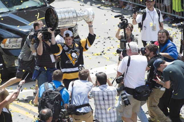 Pittsburgh Penguins' Evgeni Malkin holds the Stanley Cup during the Penguins victory parade for winning the 2016 Stanley Cup, in Pittsburgh, Pennsylvania on June 15, 2016. Thousands lined the streets in Pittsburgh to help celebrate the Penguins 2016 championship win over the St. Jose Sharks. Photo by Kevin Dietsch/UPI