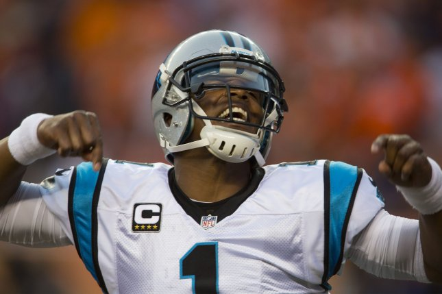 Carolina Panthers quarterback Cam Newton celebrates throwing a 14-yard touchdown pass against the Denver Broncos in the first quarter at the NFL's season opener and Super Bowl 50 rematch at Sports Authority Field at Mile High in Denver on September 8, 2016. Newton is the NFL 2015 MVP. Photo by Gary C. Caskey/UPI