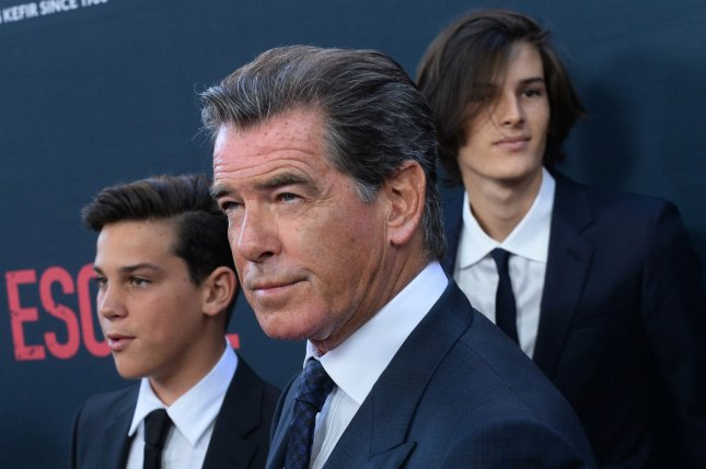 Pierce Brosnan (C) with sons Paris (L) and Dylan at the Los Angeles premiere of No Escape on August 17, 2015. The actor denied Tuesday that he'll play Cable in Deadpool 2. File Photo by Jim Ruymen/UPI